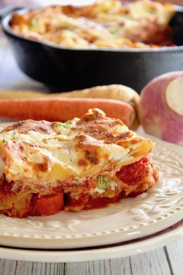 slice of root vegetable lasagna on white plate