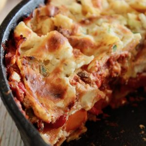 baked root vegetable lasagna sliced in iron skillet