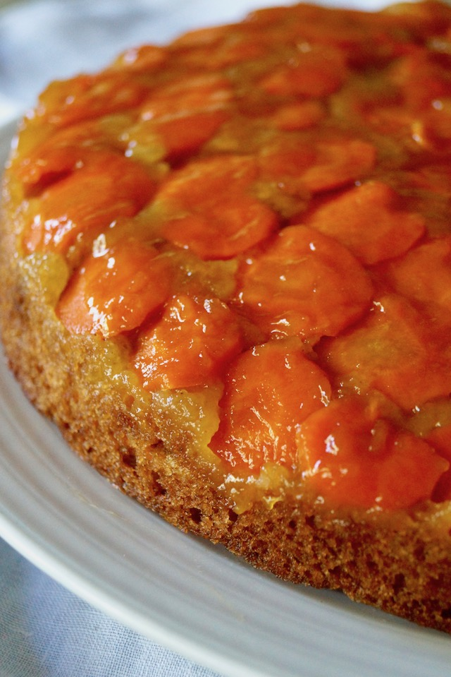 Close up of Upside Down Carrot Apricot Cake on a white plate.