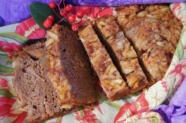 Sliced Almond-Apple-Persimmon Bread on a red and green cloth