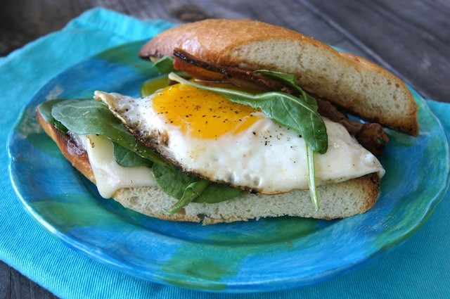 Fried Egg Sandwich with top bread sliding off to expose egg