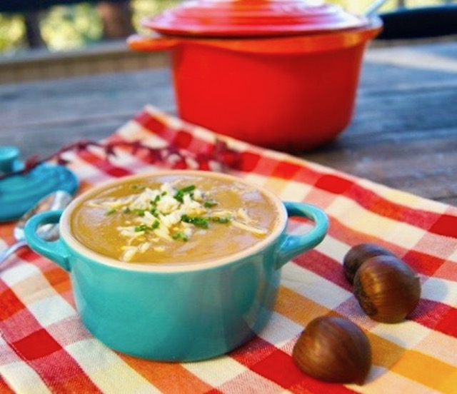 Small turquoise dutch oven filled with Cream of Chestnut-Potato Soup