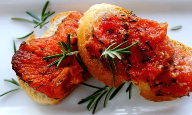 2 Rosemary Tomato Confit Croustades on a white plate.