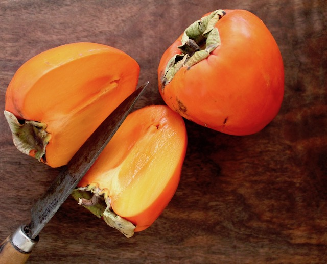 2 Hayicah persimmons, one sliced in half