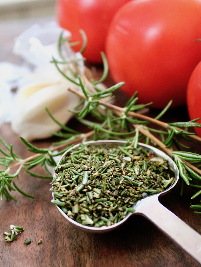 heart-shaped tablespoon with finely chopped rosemary
