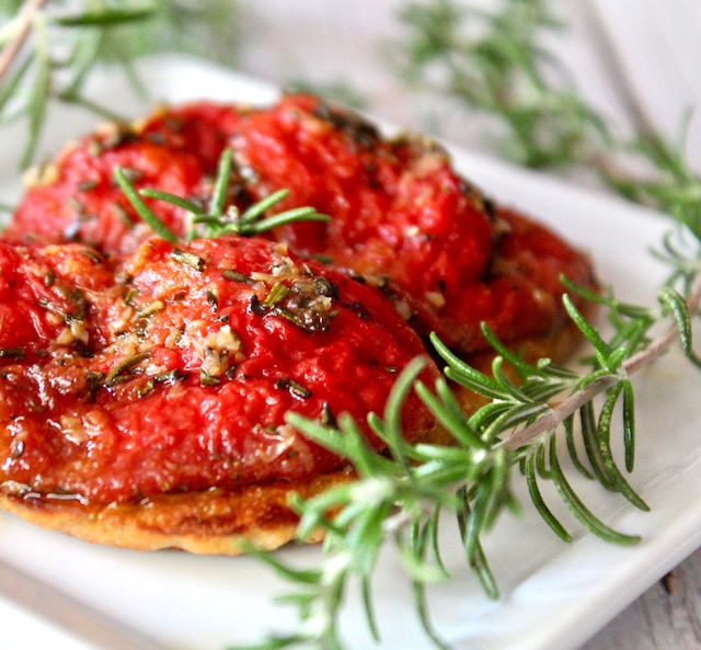 tomato confit on toast with fresh rosemary