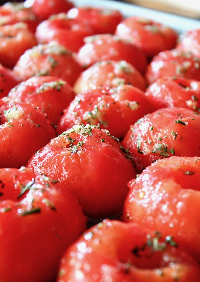 halved and peeled tomatoes with minced rosemary and garlic
