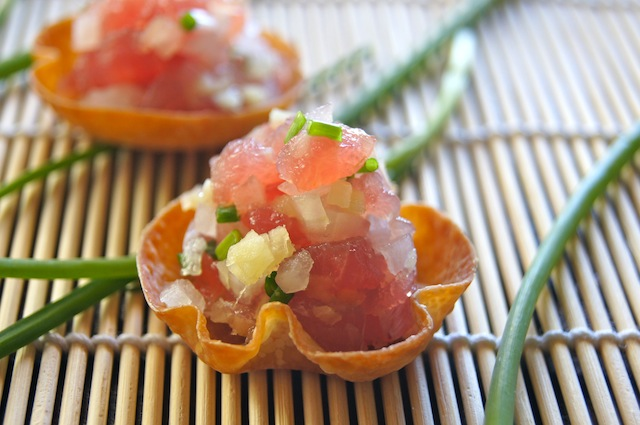 Ginger Ahi Tuna Tartare recipe in wonton cups on bamboo sushi mat