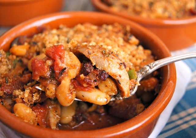 Sausage and Chicken Cassoulet bite in a spoon