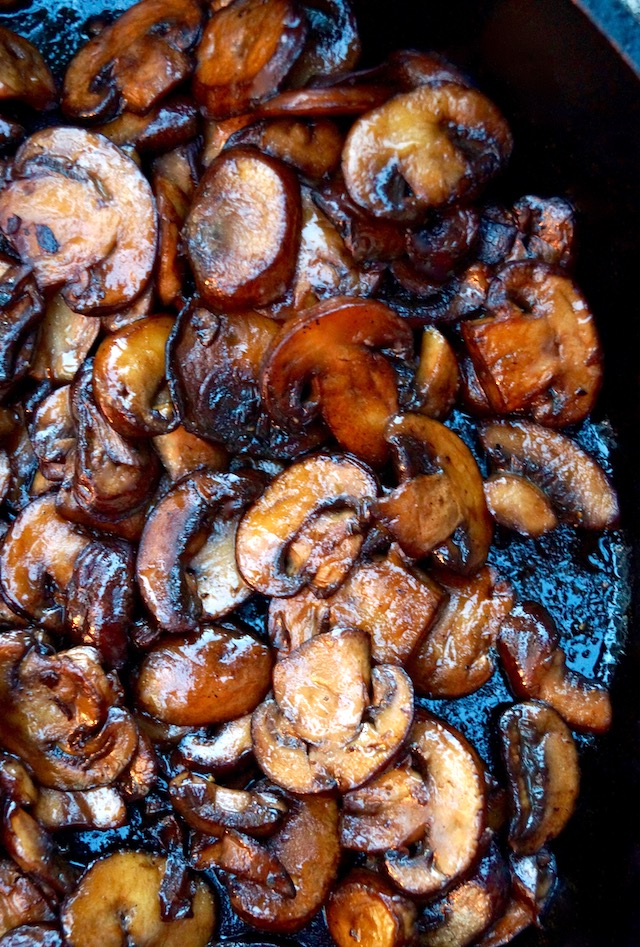 pile of browned mushrooms in pan