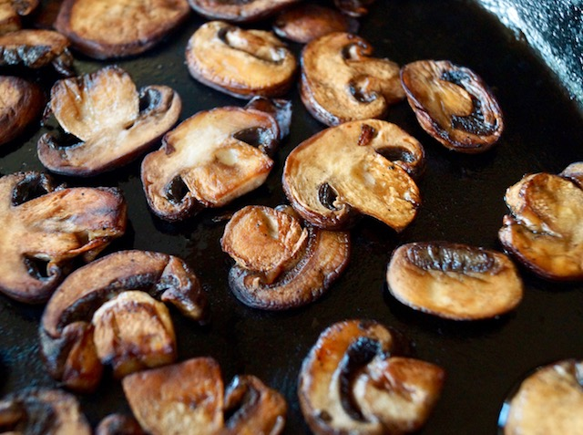 sauteed mushrooms in black pan