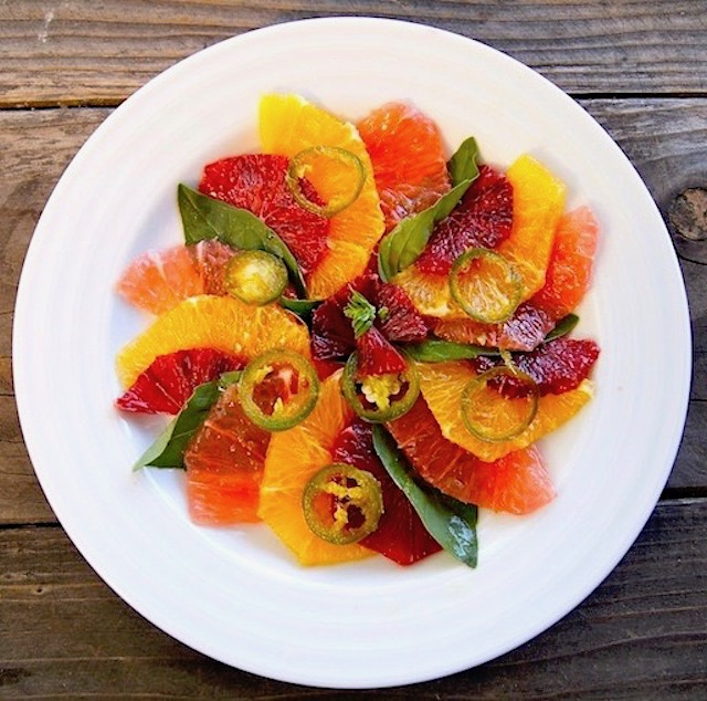 Citrus Carpaccio salad on white round plate