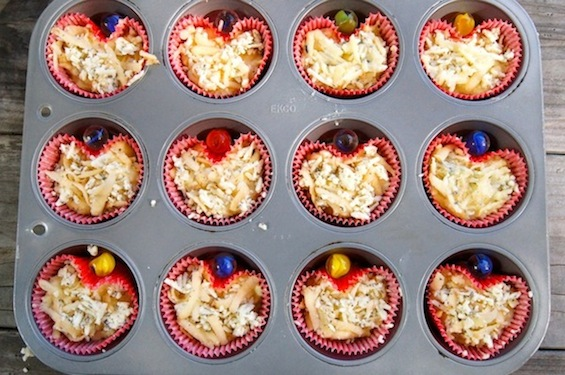 Herbs de Provence Idaho Potato Muffin batter in red heart-shaped cupcake liners in a muffin pan