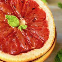 Grapefruit Brulee with fresh mint in a n orange bowl