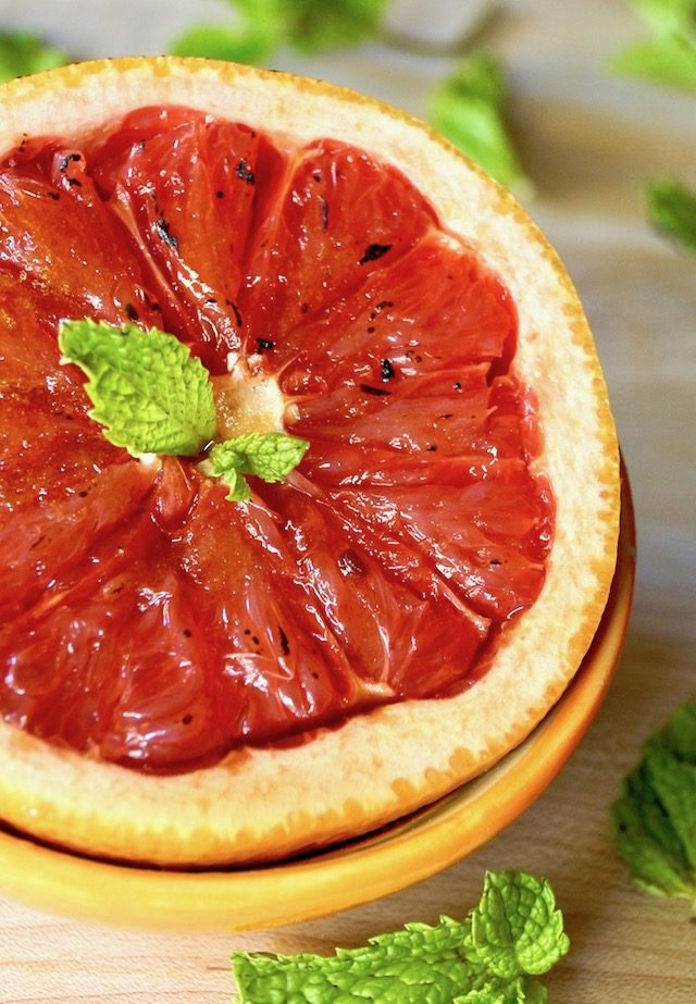 Grapefruit Brulee with fresh mint in a n orange bowl