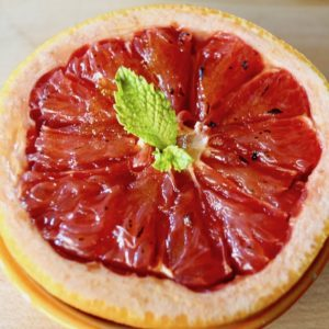 Onse serving of Grapefruit Brulee with fresh mint