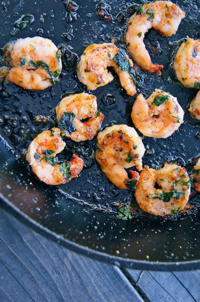 Spicy Cilantro Shrimp being cooked in a cast iron skillet.