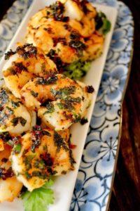 Spicy Cilantro Shrimp on a narrow blue floral plate