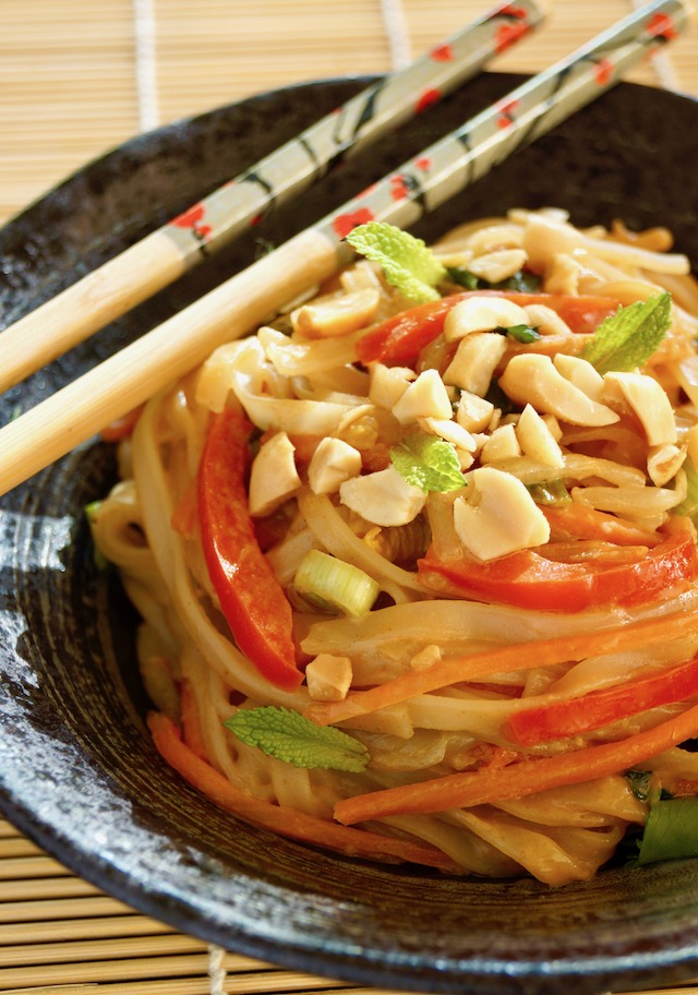 Vegetarian Pad Thai Recipe with Peanut Sauce in a black bowl with chopsticks