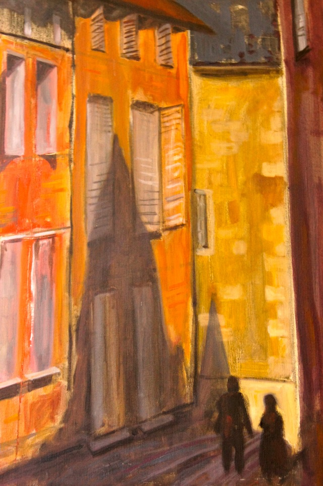 A painting of brightly colored buildings -- orange, yellow -- by Valentina's grandfather, Harry Kenney Painting