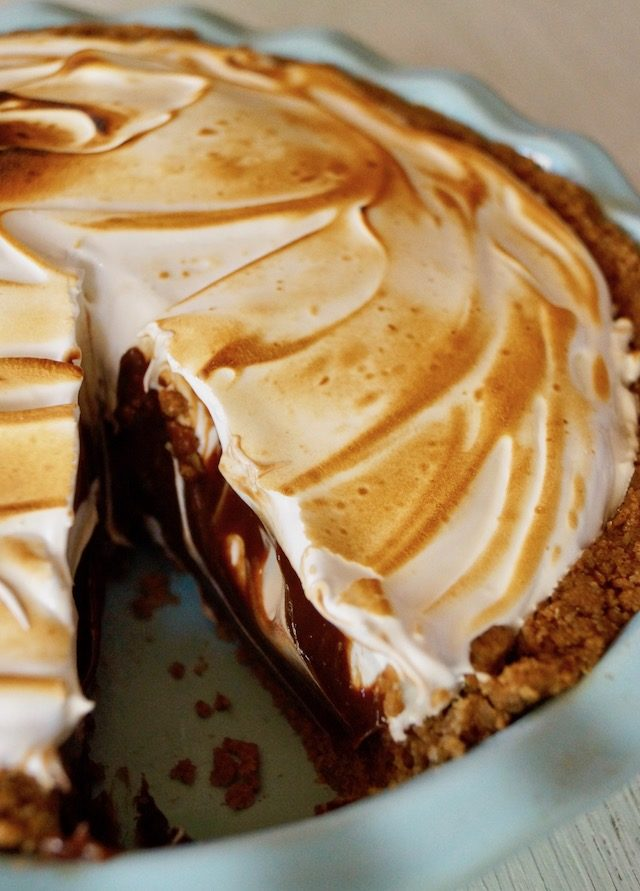Peanut Butter Chocolate Meringue Pie with one slice removed
