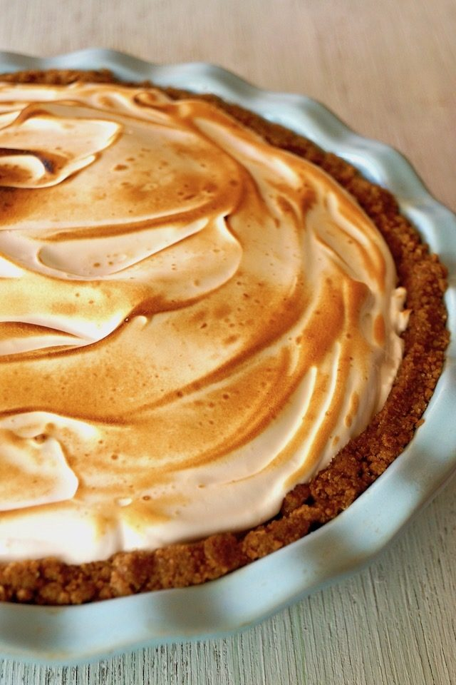 Close up of Peanut Butter Chocolate Meringue Pie in light blue pie dish