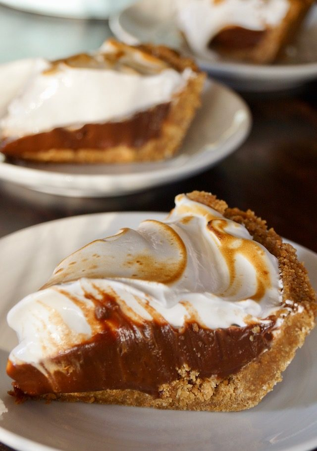 a couple of slices of Peanut Butter Chocolate Meringue Pie on white plates