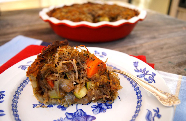 Vegetable Pot Pie Recipe for Passover on a white and blue plate with fork