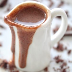 Chocolate Creme Anglaise with Frangelico dripping on the side of a white pitcher