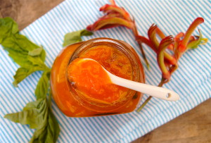 Apricot Basil Preserves in a jar and small white spoon.
