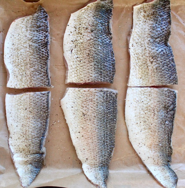 six Lake Whitfish fillets on parchment paper, skin side up