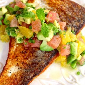 Sauteed Whitefish, skin side up with salsa on white plate