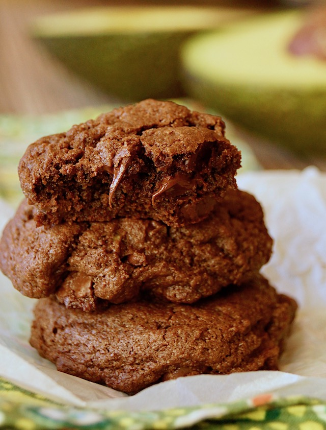 Small stack of chocolate avocado cookies with melting chocolate chips