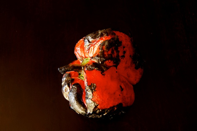 one roasted pepper with skin peeling off
