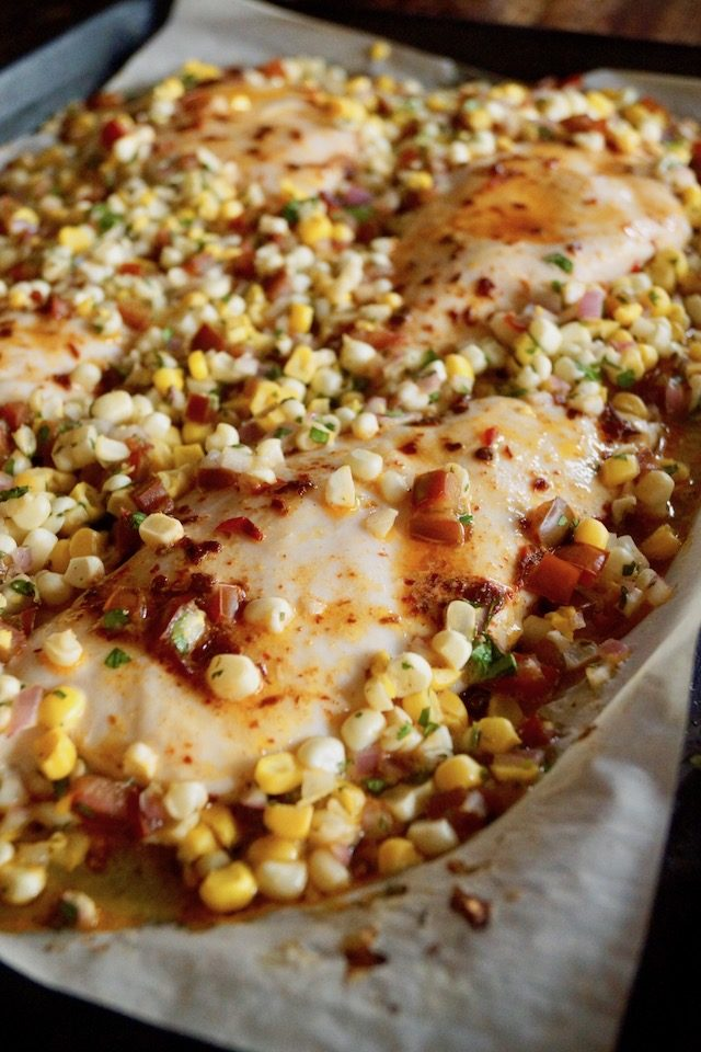 Close up of Sheet Pan Chipotle Chicken with Corn Salsa right oout of the oven on the pan