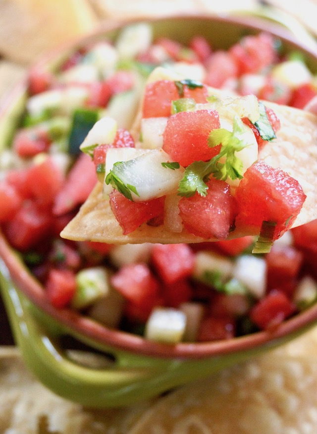Watermelon Cucumber Salsa on a chip and in a bowl below it