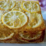 Close up, unsliced half of Gluten-Free Meyer Lemon Cake with Olive Oil.