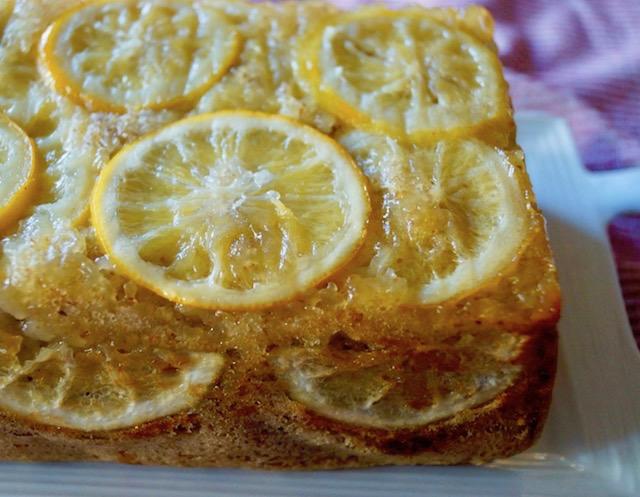 Close up, unsliced half of Gluten-Free Meyer Lemon Cake with Olive Oil.