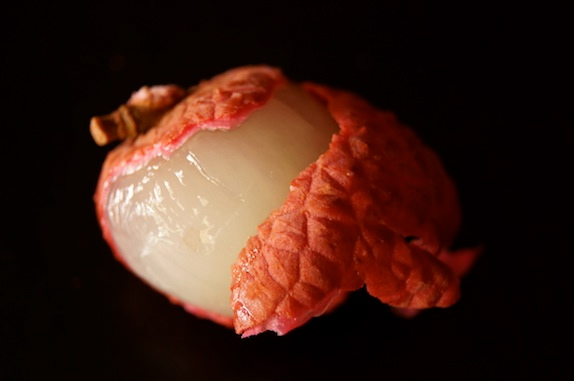 partially peeled lychee fruit