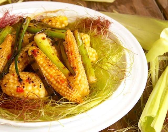 grilled baby corn stir-fry on corn silk on white plate