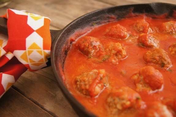 Spicy sriracha meatballs in a cast iron skillet