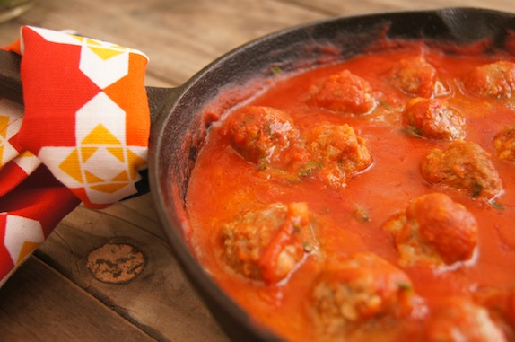 Spicy sriracha meatballs in a cast iron skillet