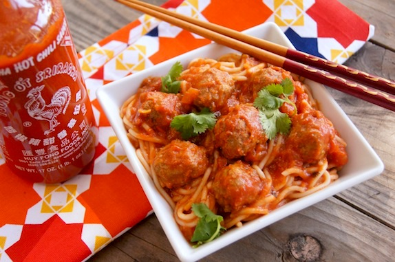 Spricy Siracha spaghetti and meatballs in a white square dish with chopsticks