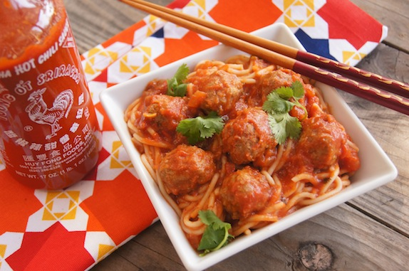 Spicy Sriracha Spaghetti and Meatballs in a white, square dish