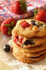 Close up of a small stack of Strawberry-Blueberry White Chocolate Chip cookies.
