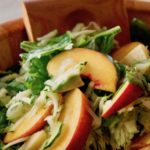 Summer Zucchini Peach Avocado Salad in a wooden serving bowl.