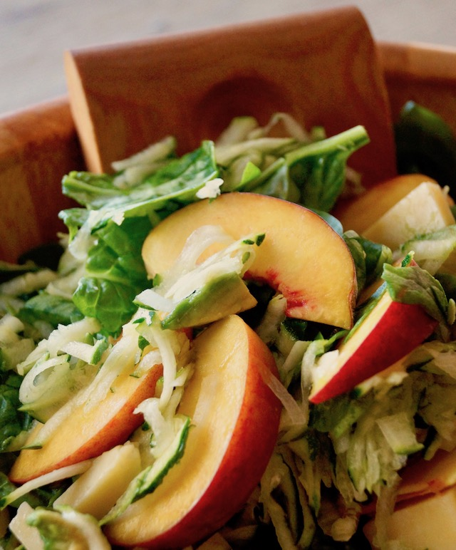 Peach and Avocado Salad with Zucchini in a wooden serving bowl.