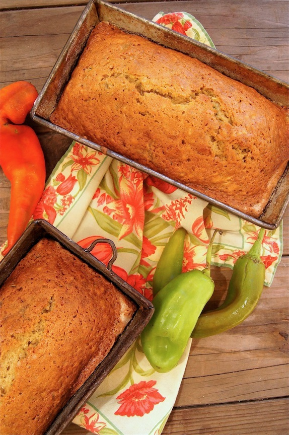 two loaves of Roasted hath Chile Zucchini Bread in bread tins.