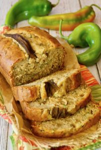 half sliced Hatch Chile Zucchini Bread on red and green cloth