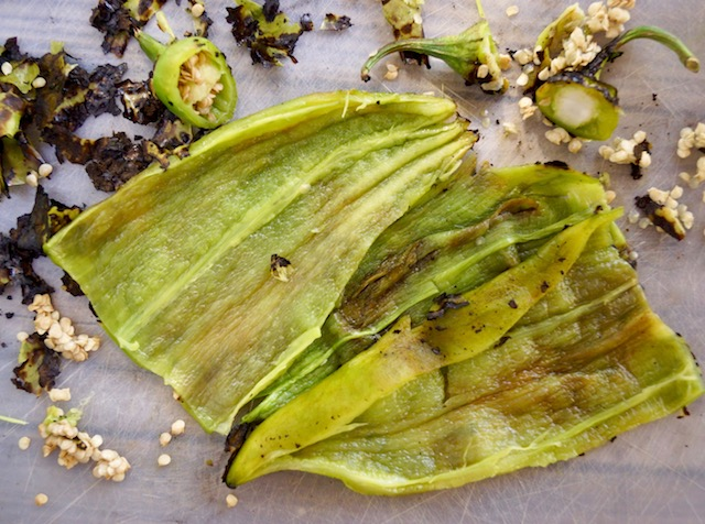 roasted hatch chiles with seeds removed on cutting board